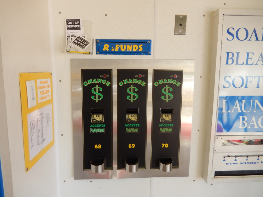 Change machine and refund slips at Walden Square Laundromania West Iowa City