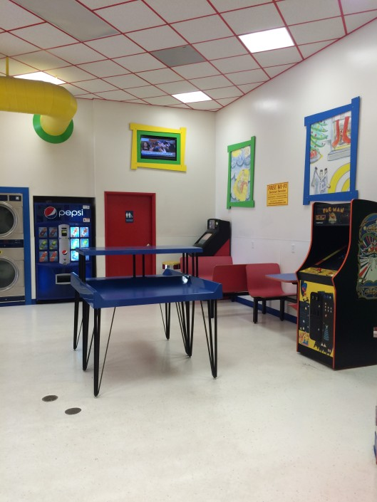 Folding tables arcade games and soda machine at Laundromania Northwest Plaza Davenport, Iowa