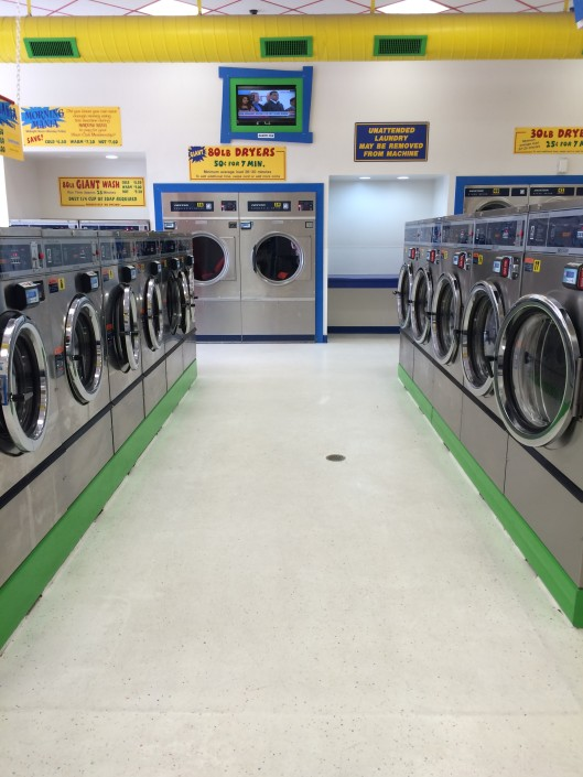 Multiple front load washing machines at Laundromania Northwest Plaza Davenport Iowa