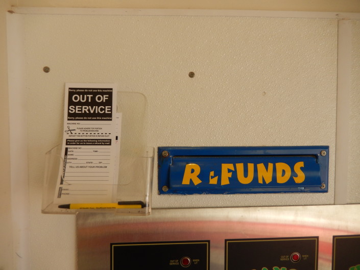 Refund slip and deposit area at Walden Square Laundromania West Iowa City
