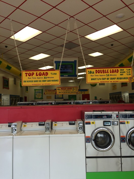 Top and front load washing machines at Laundromania Northwest Plaza Davenport Iowa