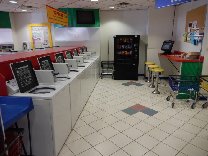 Top load washing machines and snack machine Walden Square Laundromania