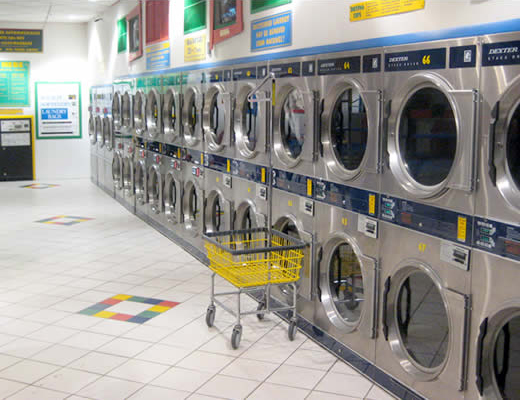 Bank Of Stacked Coin Operated Industrial Washing Machines