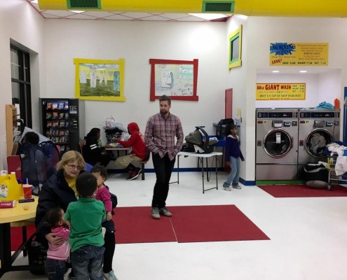Families at free Laundry event thanks to Laundry Love QC at Laudromania Davenport