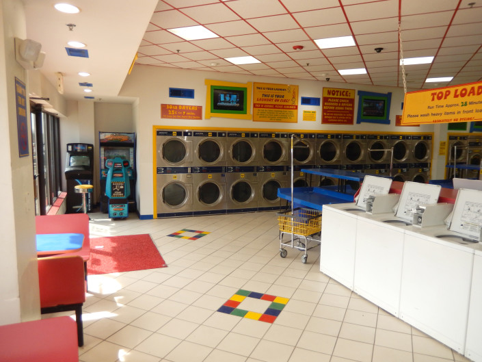 Inside Laundromania in North Liberty Iowa with dryers