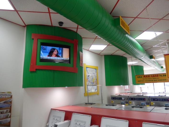 TVs inside Laundromania in North Liberty, Iowa