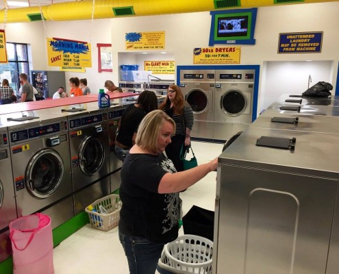 People using the washing machines during the free laundry event
