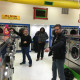 Directing traffic on free laundry night at Laundromania in Davenport Iowa