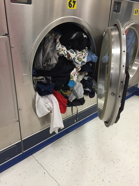 Dryer 67 full of clothes at Laundromania