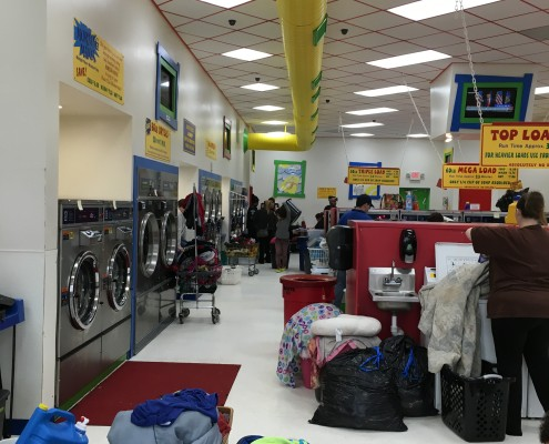 Davenport Laundromania packed with Families at free Wednesday laundry event on April 6 2016 in Davenport, Iowa