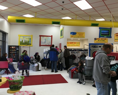 Families at Wednesday April 6 2016 Free Laundry event at Laundromania in Davenport, Iowa