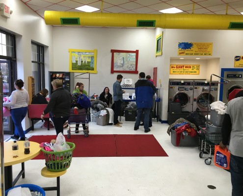 Families waiting at Wednesday April 6 2016 Free Laundry event at Laundromania in Davenport, Iowa
