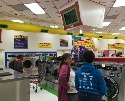 Front load washing machines going at Wednesday April 6 2016 Free Laundry event at Laundromania in Davenport, Iowa