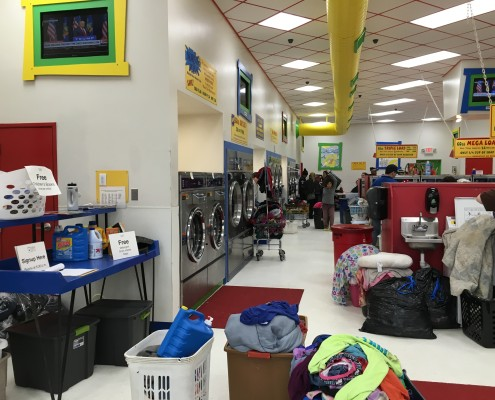 Laundromania packed with Families at free Wednesday laundry event on April 6 2016 in Davenport, Iowa