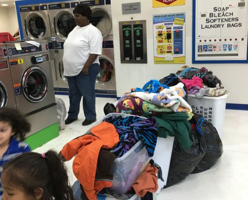 Loads of laundry at free Wednesday laundry event in Davenport, Iowa