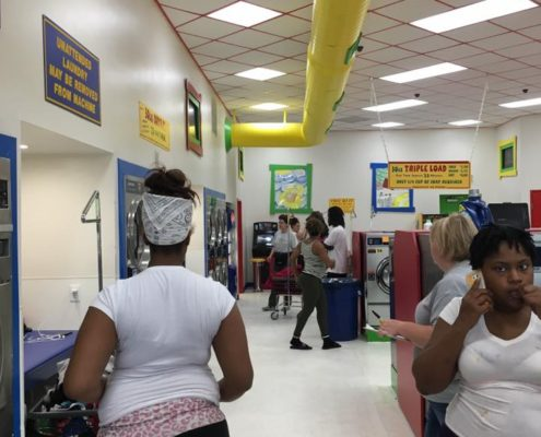Group of people at free Laundry event sponsored by Laundry Love QC at Laundromania on June 1st 2016