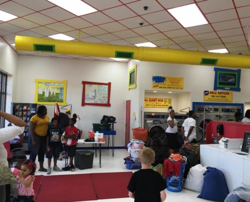 Lots of people at the free Laundry event sponsored by Laundry Love QC in Davenport, Iowa on June 1st 2016