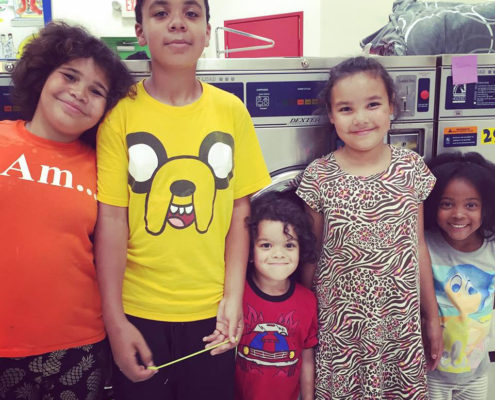 Children at the Wednesday July 6th free laundry event by Laundry Love QC at Laundromania Davenport, Iowa