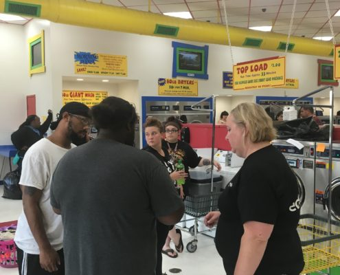 People at the free laundry event at Laundromania in Davenport Iowa on Wednesday, Aug 3rd 2016