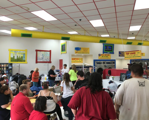 People at Laundromania for Laundry Love QC Free Laundry Washing Event in Davenport, Iowa in September