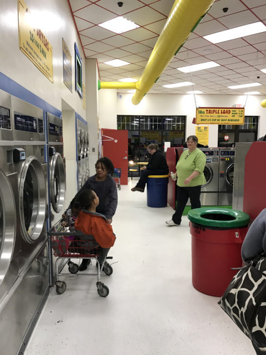 By the dryers at Laundry Love QC event at Laundromania in Davenport, Iowa