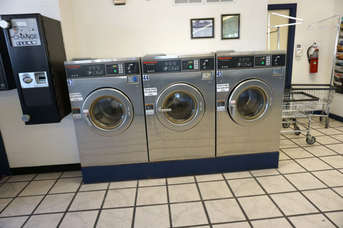50lb Speed Queen front load washing machines inside Laundromania Coralville 24 hour Laundromat