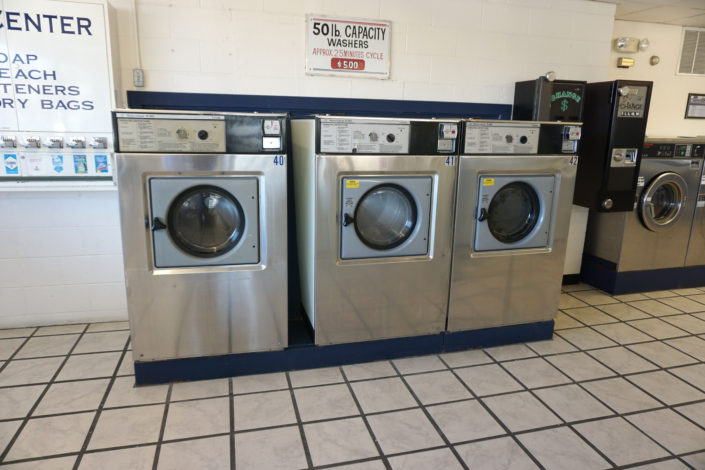50lb front load washing machines inside Laundromania Coralville 24 hour Laundromat