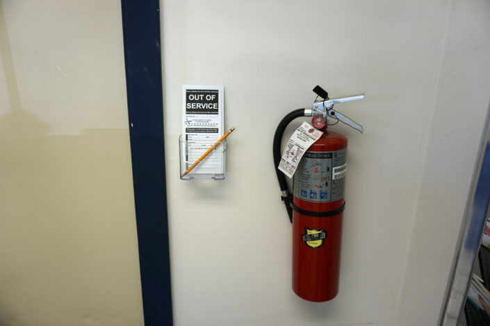 Form and fire extinguisher inside Laundromania Coralville 24 hour Laundromat