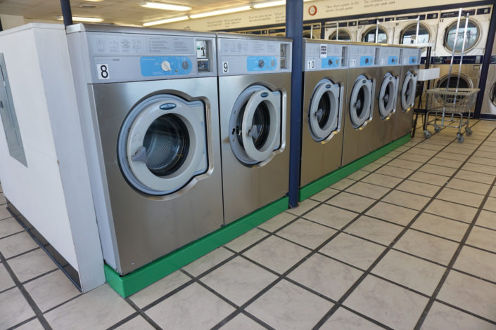 Row of 20lb capacity W620 Wascomat machines inside Coralville Laundromania 24 hour Laundromat