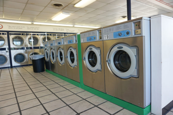 Row of 20lb capacity W620 Wascomat machines inside Coralville Laundromania 24 hour Laundromat the old Spin City Laundry