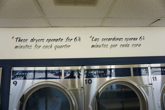 Sign above 30lb dryers inside Coralville Laundromania 24 hour Laundromat