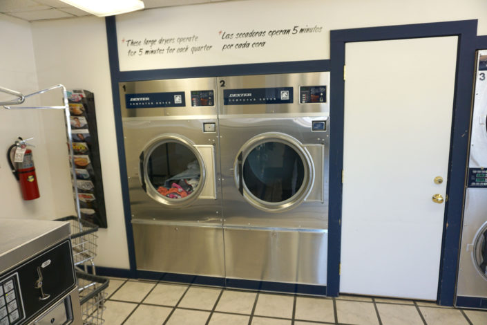 Two 50lb dryers inside Laundromania Coralville 24 hour Laundromat
