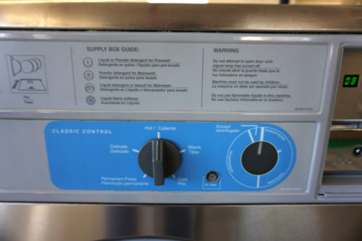 Washing machine controals and detergent guide on the 20lb washing machinine inside Coralville Laundromania 24 hour Laundromat