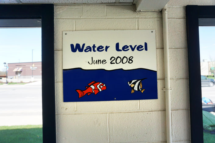 Water Level sign for 2008 flood inside Laundromat